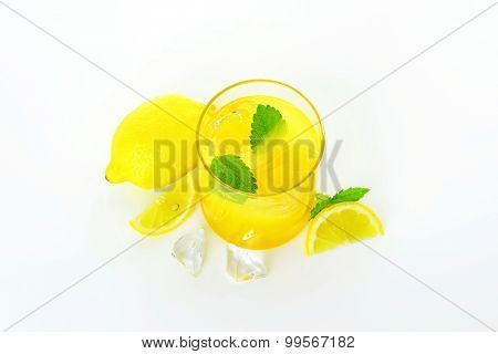 Glass of fresh lemon juice drink with ice
