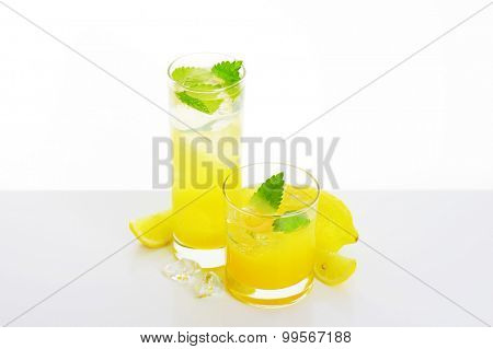 Glasses of fresh lemon juice drink with ice