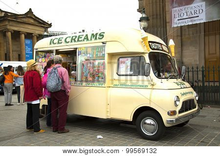 EDINBURGH - AUGUST 8, 2015: People queuing at a retro truck selling ice cream cone.