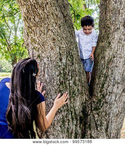 Latina Mother And Son At A Tree