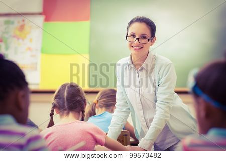 Teacher helping a pupil during class at the elementary school