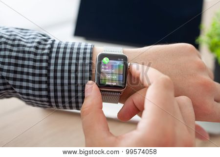 Man Hand With Apple Watch And Missed Call On The Screen