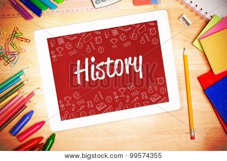 The word history and school wallpaper against students desk with tablet pc