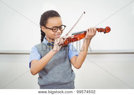 Student using a violin in class at the elementary school