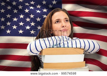 Students studying against digitally generated american national flag