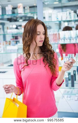 Pretty woman shopping for make up at the pharmacy