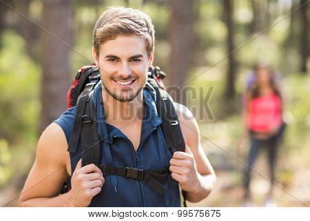 Young happy jogger looking at camera in the nature