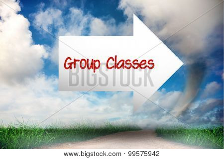 The word group classes and arrow against road leading out to the horizon