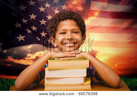 Happy pupil against composite image of united states of america flag