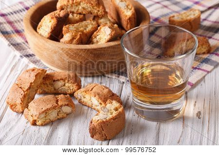 Almond Biscotti Biscuits And Sweet Wine In A Glass. Horizontal