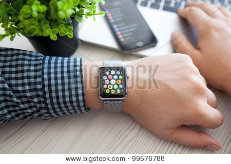 Man Hand With Apple Watch And App Icon On Screen