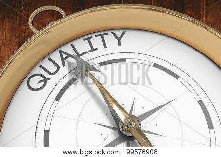 Compass pointing to quality against weathered oak floor boards background