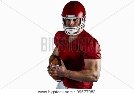 American football player holding ball on white background