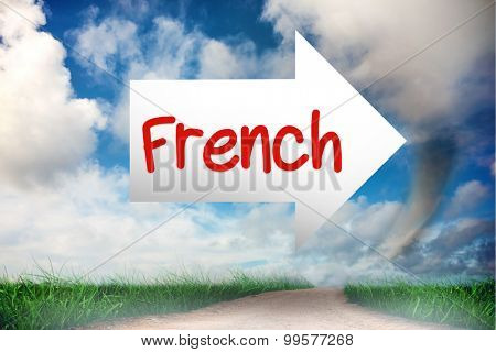 The word french and arrow against road leading out to the horizon