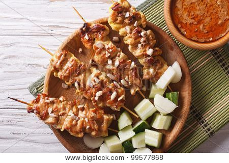 Chicken Satay With A Delicious Peanut Sauce Closeup. Horizontal Top View
