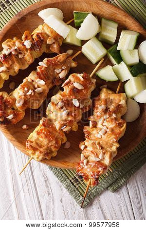 Chicken Satay Sprinkled With Peanuts Close-up. Vertical Top View