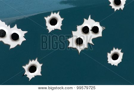 Bullet Holes Punched Through Metal