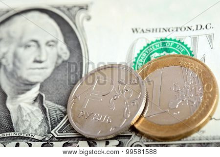 Euro and russian coins over dollar bill. Currency exchange concept