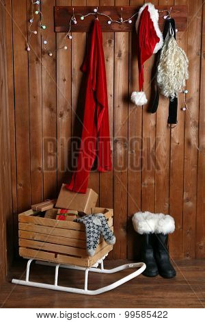 Santa costume hanging on wooden wall background