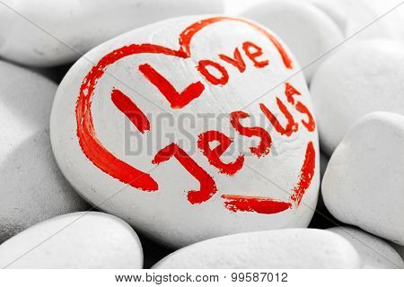 Pebbles with inscription I LOVE JESUS, closeup