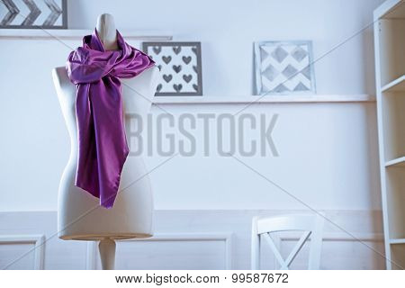 Mannequin with cloth in room