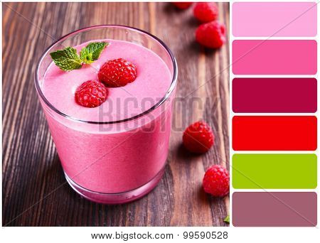 Glass of raspberry milk shake with berries and palette of colors