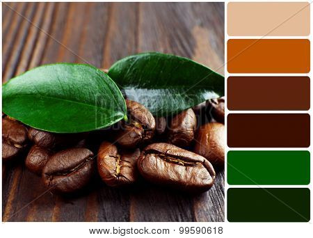Coffee beans with leaves on wooden background and palette of colors