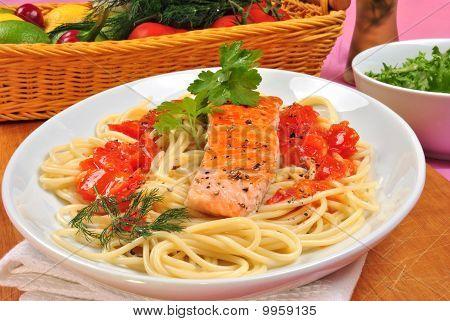 Grilled Organic Salmon On Some Tomato Spaghetti