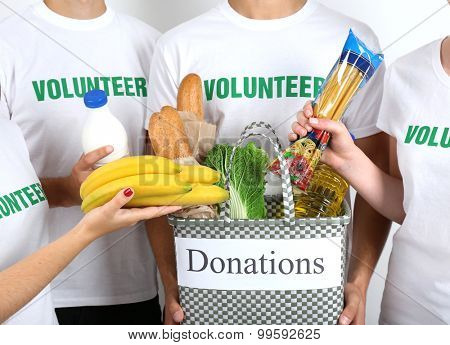 Volunteer holding donation bag with food, closeup