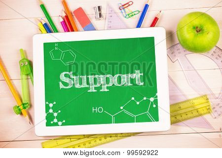 The word support and science graphic against students desk with tablet pc