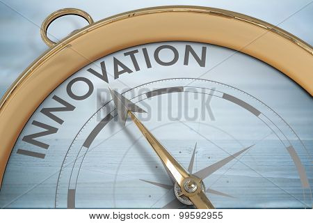 Compass pointing to innoavtion against bleached wooden planks background