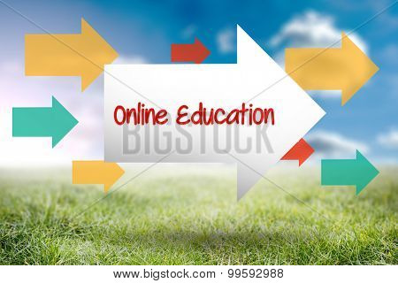 The word online education and arrow against sunny landscape
