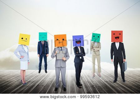 People with boxes on their heads against clouds on the horizon