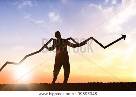 businessman with arrow against sun shining