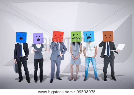People with boxes on their heads against abstract grey room