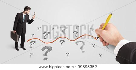Business man looking at question marks and solution path concept drawn by hand