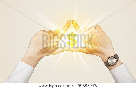 Hands creating a form with shining dollar sign in the center