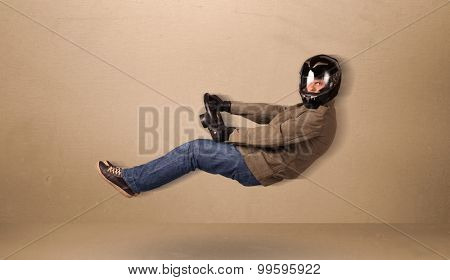 Happy funny man driving a flying car concept on background