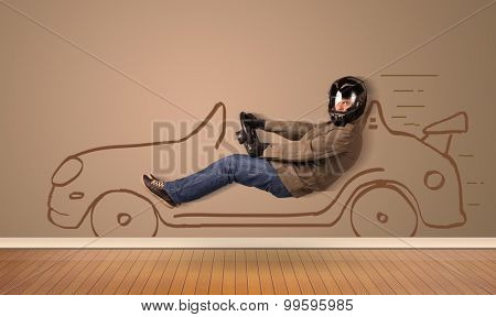 Happy man driving an hand drawn car on the wall concept