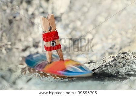 Abstract Sport Concept With Surfing Clothespin. Surfer Girl On A Wave