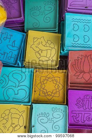 Tiny colorful Rangoli stencils displayed in a shop. Close up.