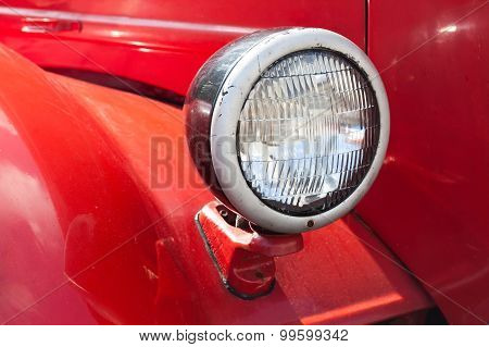 Retro Automotive Lamp. Red Car Body Background