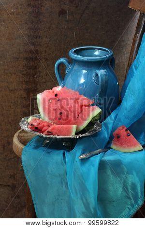 Dark Blue Jug And Ripe Water-melon On A Copper Dish