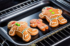 picture of gingerbread man  - Baking Gingerbread man in the oven - JPG
