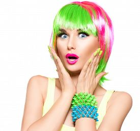 stock photo of hair dye  - Surprised Beauty Fashion Model Girl with Colorful Dyed Hair - JPG