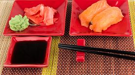 pic of soy sauce  - Portion of sushi with soy sauce ginger wasabi on mat - JPG