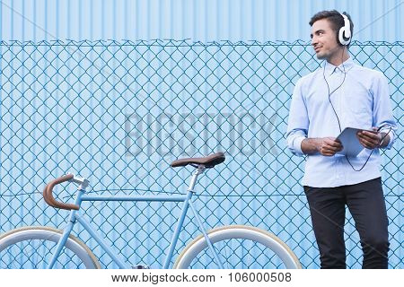 Businessman With Headphones And Tablet