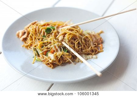 Traditional Thai Food, Pad Thai, Noodles With Vegetables And Meat On The Table