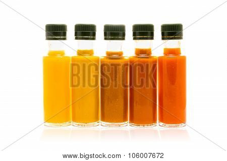 Different Color Home Made Hot Sauce In Glass Bottles