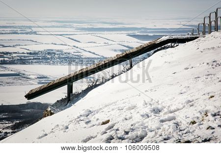 Wooden Springboard For Paragliders In Snowy Landscape